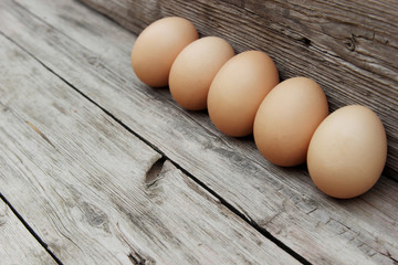 Eggs on the wooden background