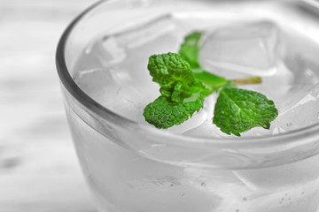 Glass of water with ice and mint, closeup