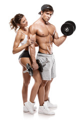 Muscular bodybuilder with woman doing exercises with dumbbells