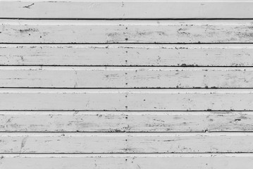 Section of weathered white wood panelling from a beach hut, suitable for backgrounds of beach, seaside and summer holiday themes.