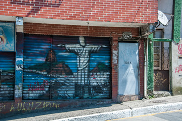 Rio de Janeiro, Brazil - December 14, 2015: Christ the Redeemer street art in Rocinha favela, documentary editorial.