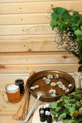 Spa chamomile herbs wooden background