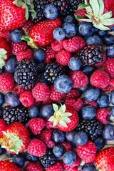 Group of blueberries, raspberries, blackberries and strawberries
