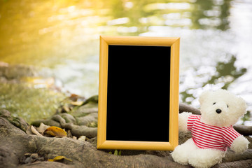 Teddy bears and picture frames with river in background ,have sp
