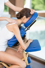 Side view of woman receiving back massage