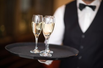 Waiter with tray of champagne