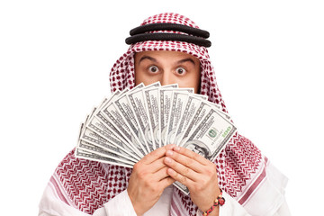 Arab hiding behind a stack of money