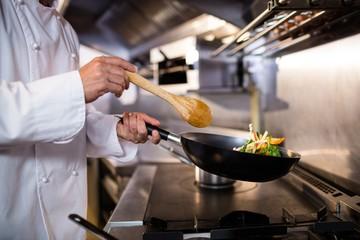 Chef preparing food in the kitchen