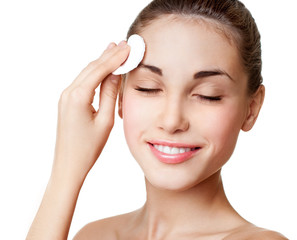 Woman using cotton pad. Happy smiling beautiful young woman clea