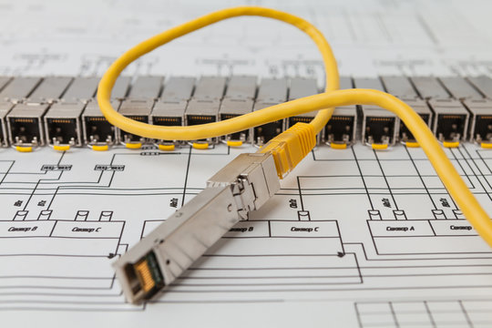 Electric gigabit sfp modules for network switch on the blueprint of  communication equipment and patch cord
