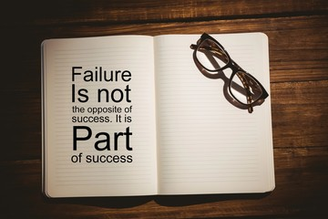 Composite image of success quote on book