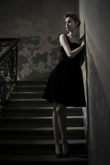 Model posing on the staircase
