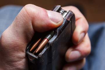 Loading 5.56 ammo magazine for machine guns