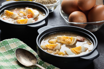 The sour soup made of rye flour with eggs