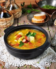 Soup of dry peas, vegetables with smoked sausage