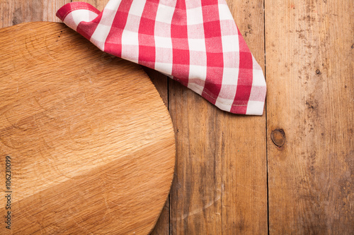 Empty wooden, cutting board, vintage tablecloth on nature