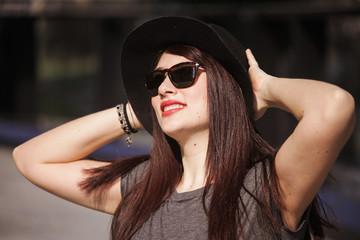 Young beautiful woman enjoying in the city