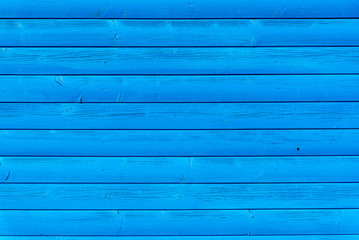 Section of blue wooden panelling from a seaside beach hut. Ideal as a background for summer holiday and beach themes.