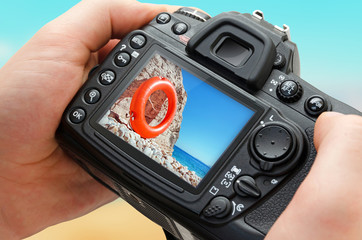 Photo of beach on camera display during the summer vacation. Travel photography.