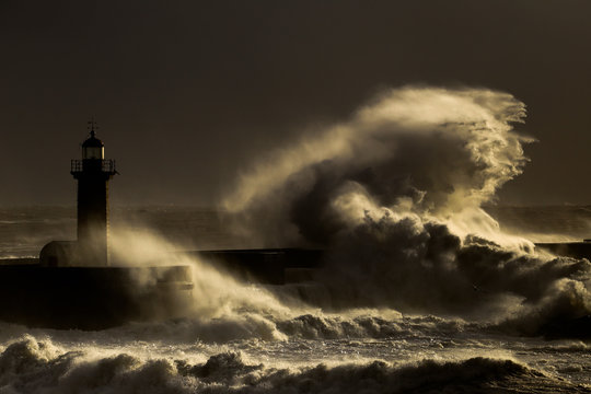 Storm with big waves near a lighthouse
