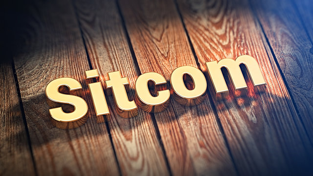 Word Sitcom on wood planks