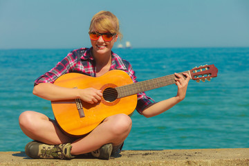 Young woman with guitar outdoor