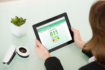 Businesswoman Hand With Digital Tablet Showing Credit Score