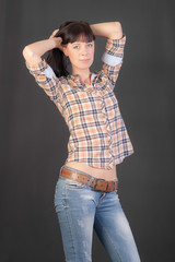 slim girl in shirt and jeans
