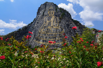 Buddha carved on cliff