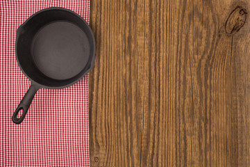 Empty pan on wooden deck table with tablecloth. Flat mock up for