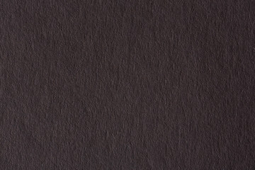 Background from dark gray paper texture.