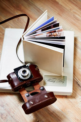 photobook with a cover of light leatherette with the old camera