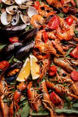 Fresh mussels, crayfish, shrimp on a wooden board. Seafood platt