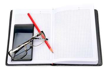 mobile phone, glasses and notebook isolated on white background