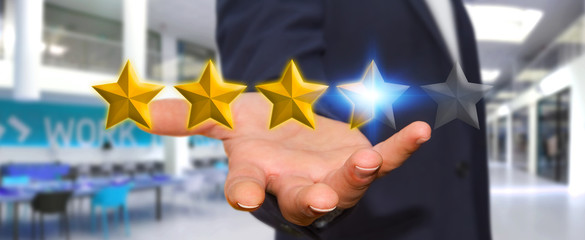Businessman rating stars with his hand