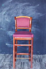 red chair and grunge gray wall