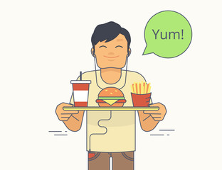 Happy guy holds a tray with big hamburger, french fries and milkshake and going to eat it. Isolated on white with green bubble and text yum