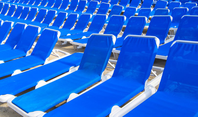 Many blue deck-chairs