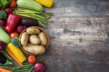 Foto op Plexiglas Groenten Various vegetables on a rustic wood