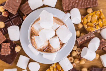 A cup of coffee with marshmallows. Marshmallows, chocolate and o