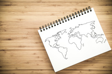 World map outline on notebook