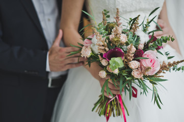 Bouquet of colorful flowers in the hands of the bride 5728.
