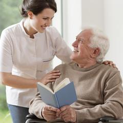 Elderly man reading book