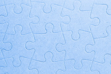 Connected blank jigsaw puzzle pieces as background
