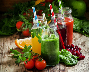 Mix of healthy fruit and vegetable juices in small bottles with