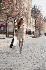 Shopping. Young beautiful brunette woman