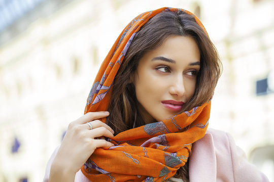 Close up portrait of a muslim young woman wearing a head scarf