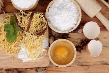 Making noodle with wheat flour and egg for cooking.