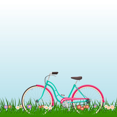 Spring landscape with a woman bike on grass with flowers