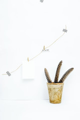 Scandinavian hipster interior design. Mock up. Vintage with quill and quotes hanging on the wall with place for text. Be happy